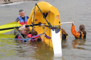 RYA Level 1 Sailing Course - Students Practice Capsize